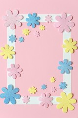 Pink background with colorful flowers and frame for text.