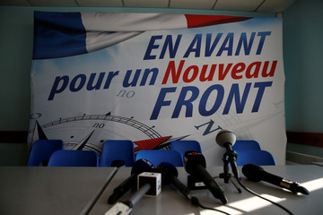 French National Front's banner is seen before a news conference in Laon