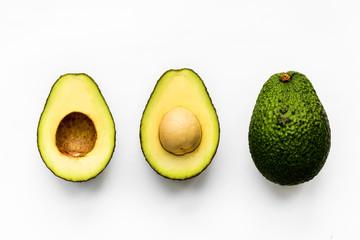 Macro shot of avocado isolated on white background