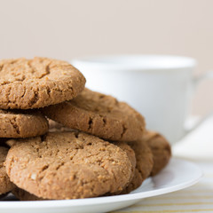 Healthy breakfast with oatmeal cookies or oatcakes and cup of tea or coffee