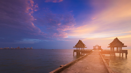 Beautiful after sunset sky with walking way leading to ocean skyline, natural landscape background