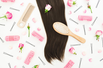 Hairdresser tools for hair styling and roses flowers on white background. Beauty composition. Flat lay, top view