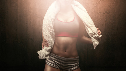 Fitness sporty woman with towel after workout competition