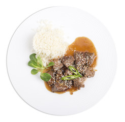 Beef tenderloin with rice in oyster sauce.