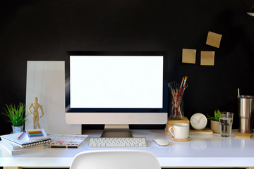 Stylish workspace mockup with desktop computer and designer craft accessories.