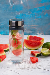 Homemade watermelon detox infused water on wooden background