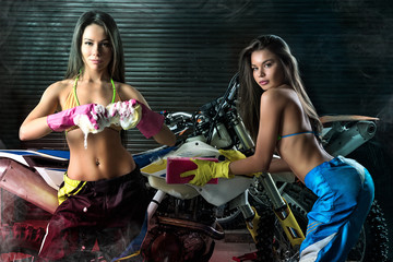 Sexy young models washing motorcycle