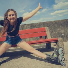 Joyful girl wearing roller skates