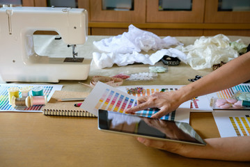 equipment on fashion designer working in studio with equipment on desk. design thing in atelier