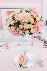 Wedding bouquet on the table with cutlery