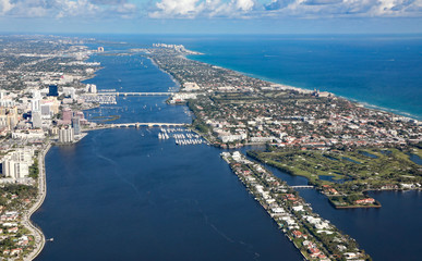 Aerial view of downtown West Palm Beach, Florida, and the upscale island of Palm Beach.