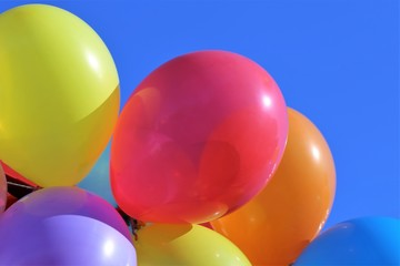 Colorful balloons against blue sky, close-up