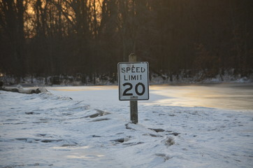 A 20 mph sign in ice jam