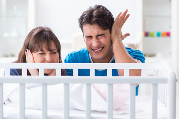 Young family frustrated at baby crying