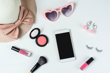 women cosmetics with fashion items and smart phone