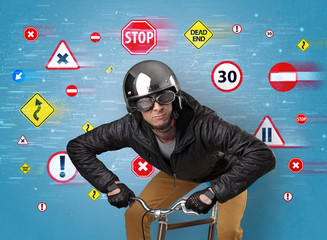 Stylish biker with highway code concept