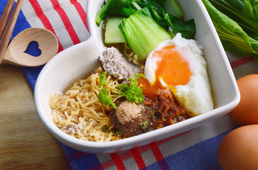 Instant noodle with egg,minced pork,bok choy in heart shape bowl