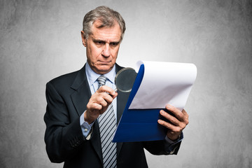Businessman analyzing a contract