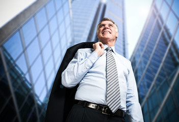 Confident businessman in front of his office