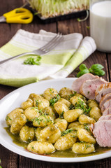 Pork tenderloin with herbs and spices, pesto gnocchi