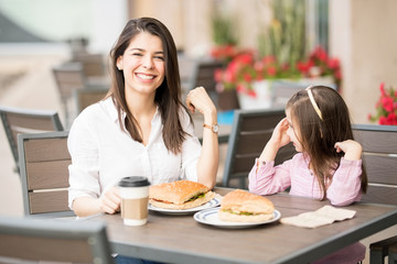 Good looking mother and daughter in a restaurant