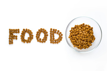Word FOOD mark made of dry food with full bowl. Pet care and veterinary concept with letters on white background.