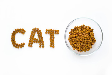Word CAT mark made of dry food with full bowl. Pet care and veterinary concept with letters on white background.