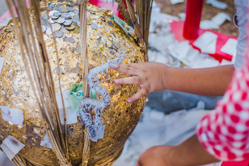 """Thailand tradition, An inauguration ceremony called """"FANG LUUK NIMIT"""" is done to consecrate a temple. Some sacred marker spheres """"LUUK NIMIT"""" need to be buried in the temple compound."""