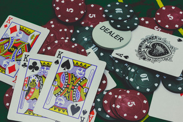 playing cards,dices and poker chips from above on green poker