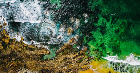 Aerial View From Flying Drone Of Ocean Waves Crushing On Rocky Beach Landscape