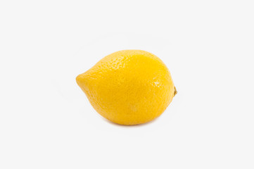 One bright juicy yellow lemon isolated on white background. Frontal view. Citrus Tropical Fruit.