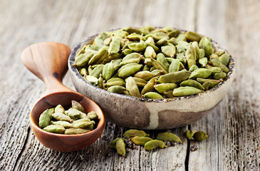 Cardamom on wooden background