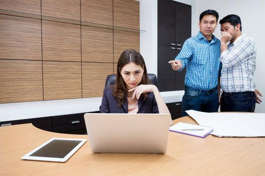 Engineer gossip to businesswoman.
