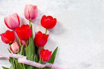 Red and pink tulips flower background. Top view with copy space.