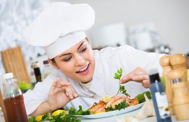Professional chef decorating baked rainbow