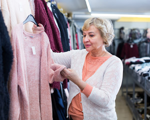 woman choosing knitwear jumper