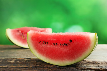 Slice of watermelon on wooden table
