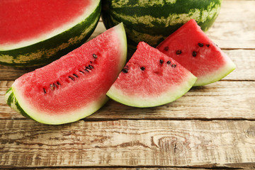 Slices of watermelons on brown wooden table