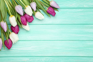 Bouquet of tulips on mint wooden table