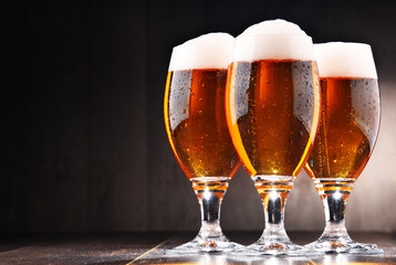 Composition with three glasses of lager beer