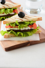 Sandwich with ham, cheese, tomatoes and fresh salad.