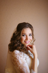 Beautiful bride perfect style. Wedding hairstyle make-up luxury dress. Young attractive model