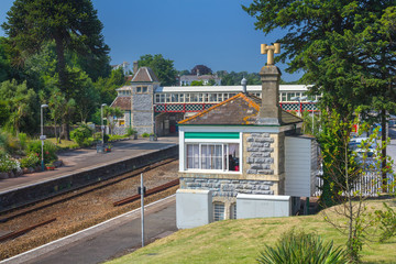 Railway station in the city of Torquay. A pedestrian crossing was made through the rails. Sunny day. Devon. UK