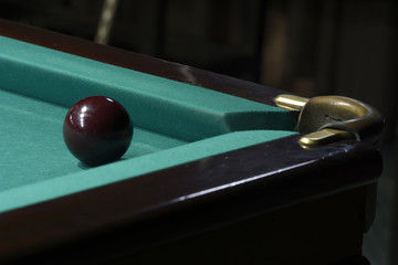 Billiard: a ball set up in front of a pocket for stroke