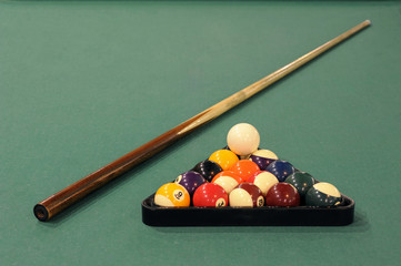 Billiard: balls set for the beginning of a game in front of green background