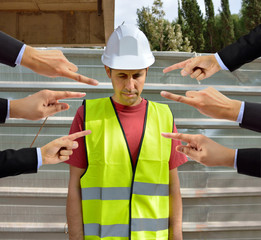 many hands pointing the bullying a workman that is suffering  mobbing on concept of accusation guilty shy,and in concept of dismissal from work
