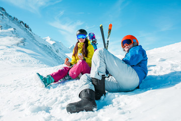 Photo of sports man and woman on snowy slope