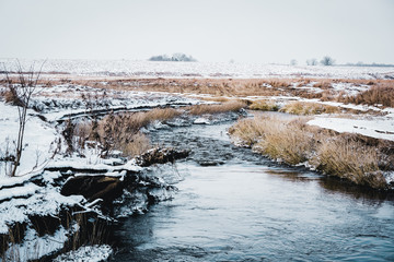 Landscape of a snowy winter river in Lithuania
