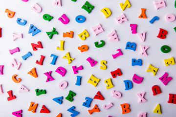 Scattered colorful wooden letters