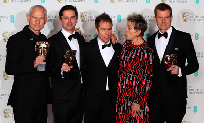 Martin McDonagh, Peter Czernin, Sam Rockwell and Graham Broadbent, pose with Frances McDormand, as they hold their trophies for Best Film for 'Three Billboards Outside Ebbing Missouri' at the British Academy of Film and Television Awards in London